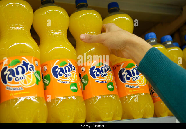 Fanta Orange Soft Drink Bottle 500 Ml owned by The Coca-Cola Company on shelves in a Carrefour Supermarket Malaga - Stock Image