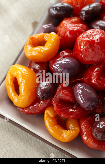 Olives and peppers, close up - Stock Image
