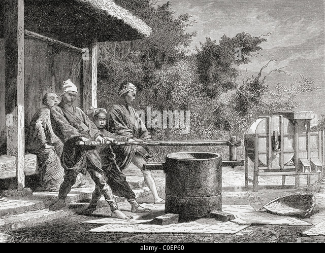 Japanese workers using a rice mill in Japan in the 19th century. - Stock-Bilder