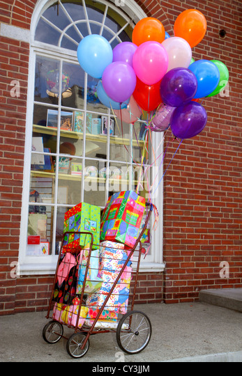 Maine Portland Congress Street cart gift bags colorful balloons - Stock Image
