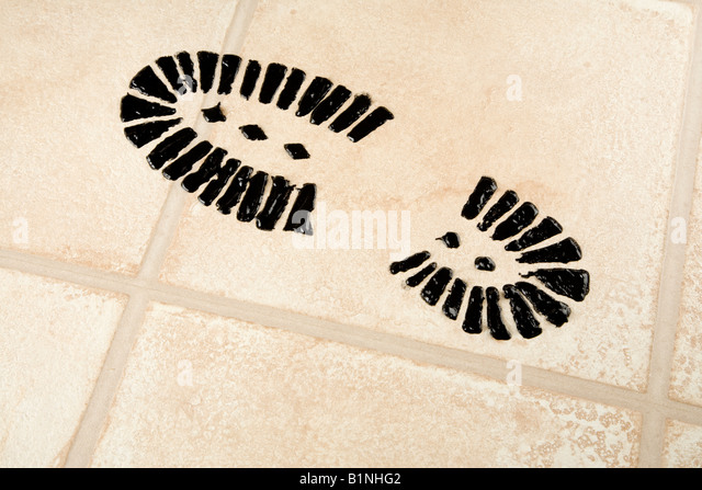 A carbon footprint on a laminate floor - Stock Image