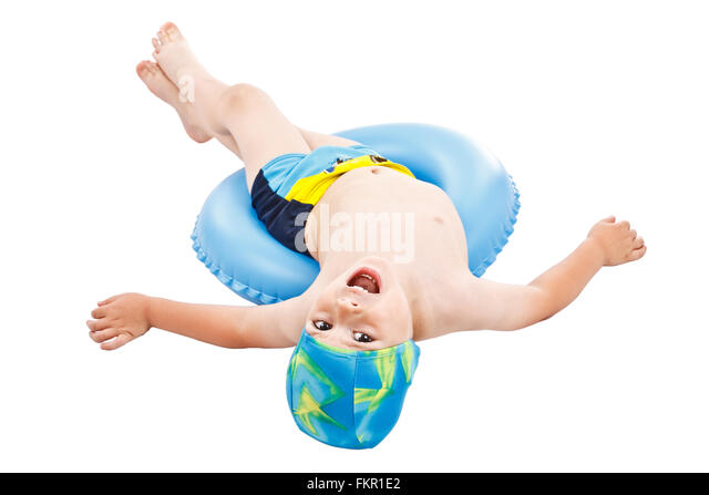 Little boy playing with blue life ring in swim caps, isolated in white - Stock Image