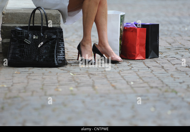 Woman with shopping bags and purse - Stock Image