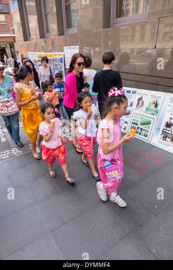 Sydney Australia NSW New South Wales Haymarket Chinatown Asian girl eating ice cream sweets woman family - Stock Image