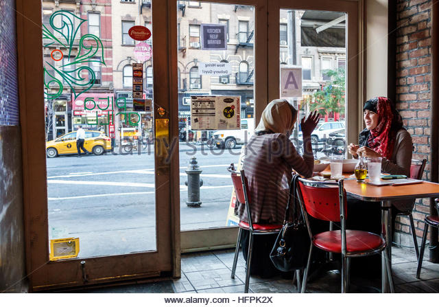 Muslim woman restaurant stock photos muslim woman for Anatolia mediterranean cuisine new york