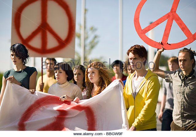 Group young people holding banner at peace demonstration Munich, Bavaria, Germany - Stock-Bilder