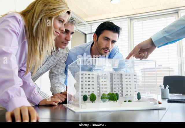 People studying architectural model - Stock Image