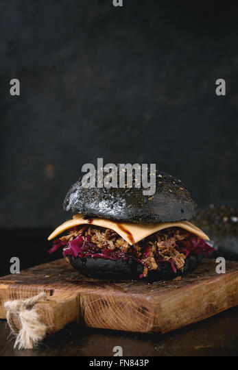 Black burger with stews - Stock Image