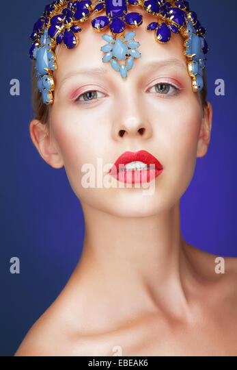 Artistry. Studio Portrait of Young Woman with Jewels - Stock Image