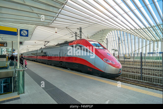 train and passengers in High Speed Train Station in Reggio Emilia, Italy. - Stock Image