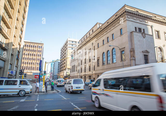 Johannesburg, South Africa – January 13, 2015: Morning walk to the busy streets of Johannesburg - Stock Image