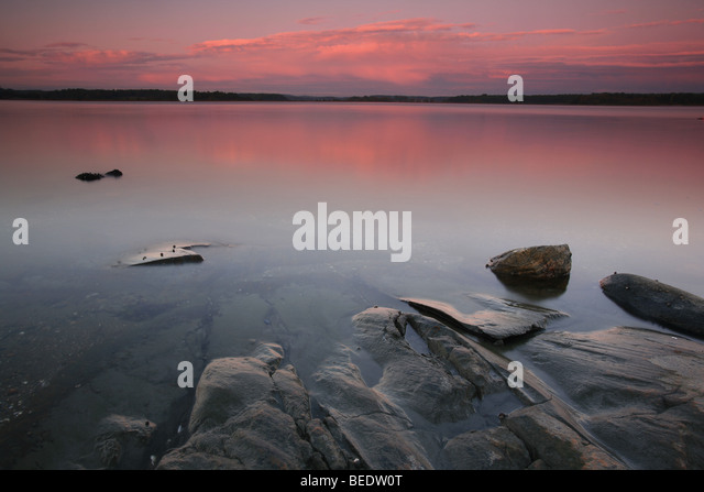 Colorful evening in Kurefjorden nature reserve, Rygge kommune, Østfold fylke, Norway. - Stock Image