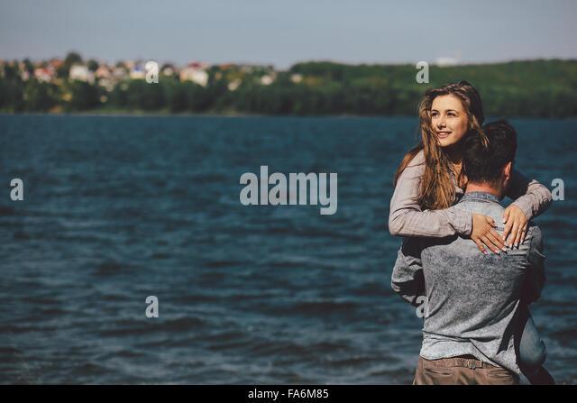 couple at the shore - Stock-Bilder