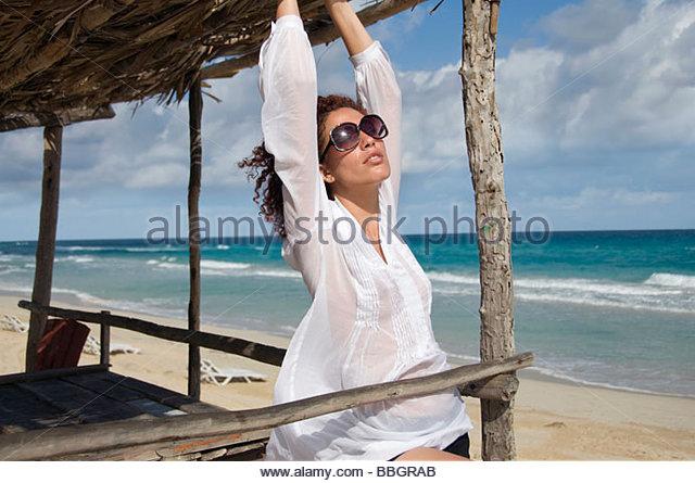 Young woman under sunshade, Havana, Cuba - Stock Image