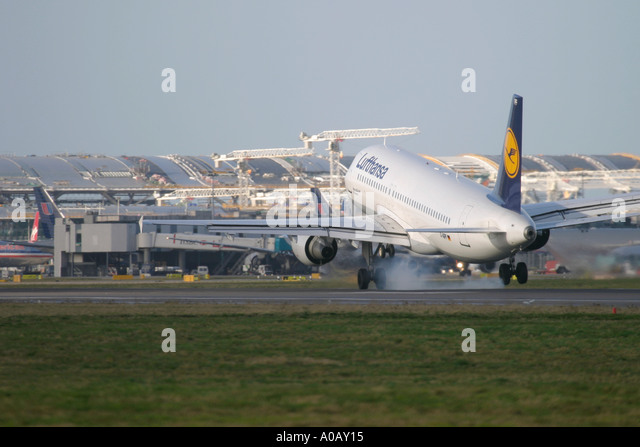 Lufthansa Airbus A320 211 D-AIPF touching down at London Heathrow. In the background visible constructing work of - Stock Image