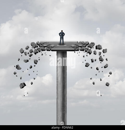 Lost connection or business concept and breaking ties as a road on a bridge breaking apart isolating a businessman - Stock Image