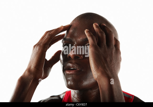 Athlete rubbing his temples - Stock Image