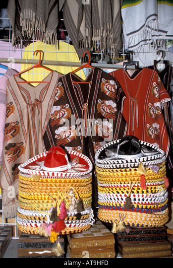 cancun mexico shopping display floppy hats sombreros serapes traditional costumes wear souvenirs - Stock Image