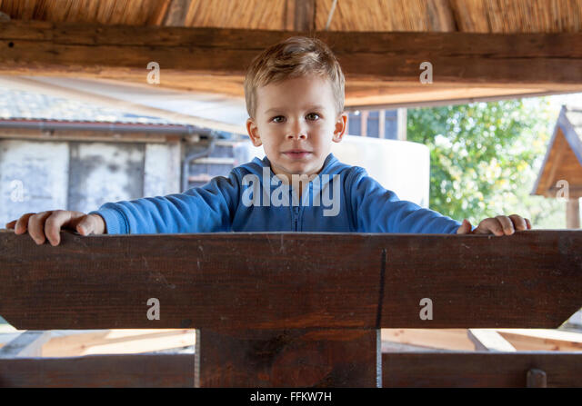 Portrait of boy with blond hair on vineyard - Stock Image