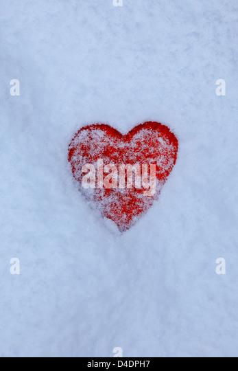 red heart in the snow - Stock-Bilder