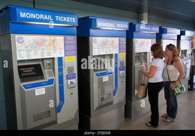 Nevada Las Vegas Bally's / Paris Las Vegas Station ticket vending machines self service woman buying - Stock Image
