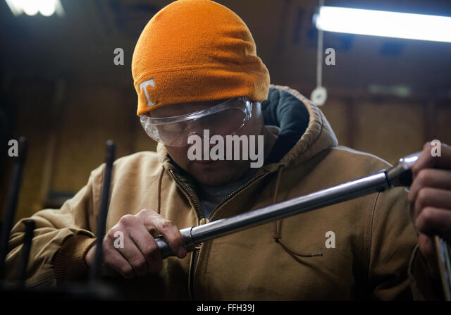 Master Sgt. Randy Rollins tunes the settings on his torque wrench to start working on the engine block of his 1958 - Stock Image