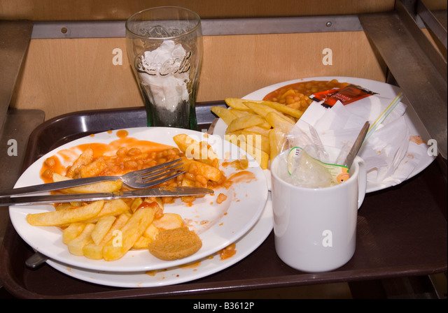 Uneaten wasted food on tray in cafe - Stock Image