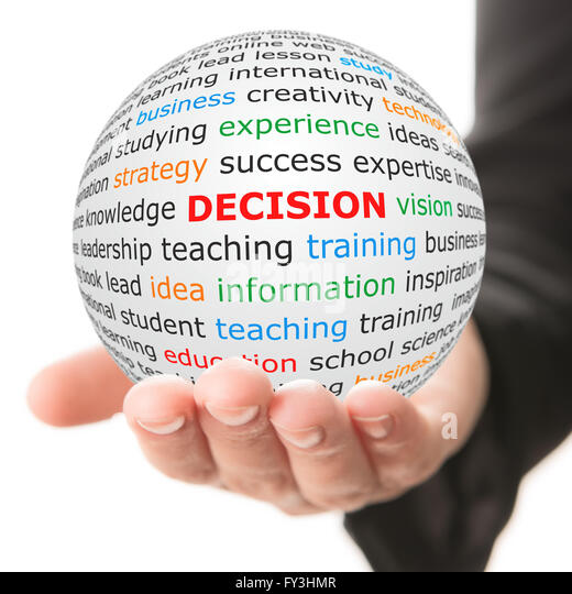 white ball in hand with red inscription decision - Stock Image