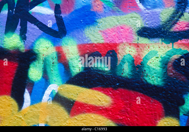 Closeup of a wall with colorful graffiti artwork - Stock Image