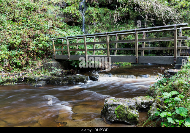 Bridge Over Ashgill Beck Below Ashgill Force on the South Tyne Trail Cumbria UK - Stock Image