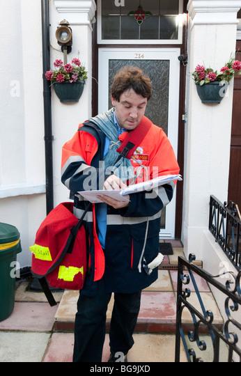 Postman delivering letters, England, UK - Stock Image