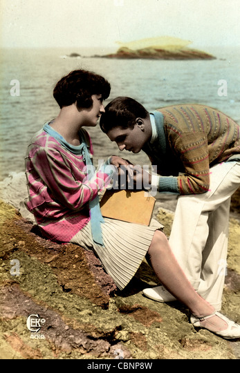 Upper Class Couple on the Beach - Stock Image