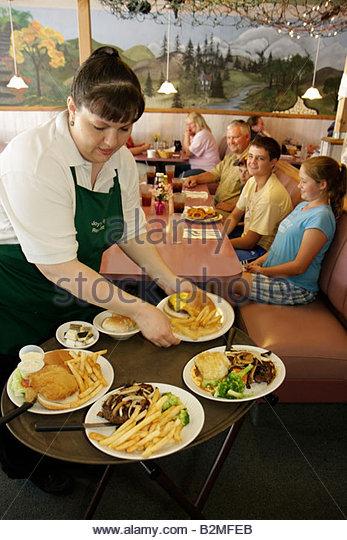 Indiana Kouts Joy's Family Restaurant comfort food platter woman waitress serve job steak vegetables cheeseburger - Stock Image
