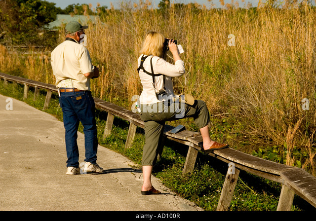 Everglades National Park Florida tourists couple wildlife watching Anhinga Trail wildlife watching ecotourism 'river - Stock Image