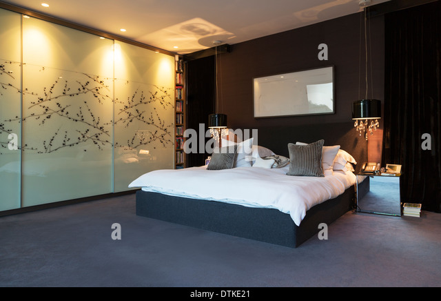 Wall art in modern bedroom - Stock Image