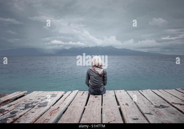 Sitting alone - Stock-Bilder