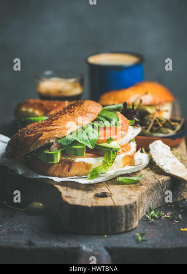 Close-up of bagel with salmon, cream cheese and vebegables - Stock Image
