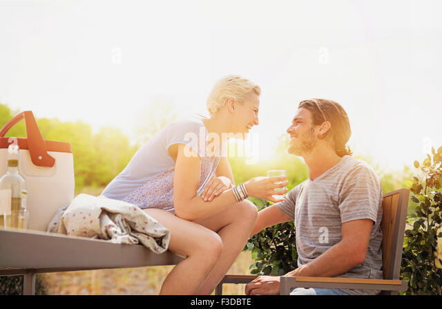 Couple laughing on rooftop - Stock Image