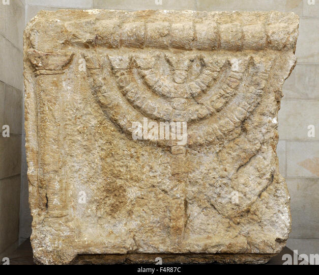 Stone lintels decorated with the Seven-Branched Menorah synagogue at Eshtemoa. Southern Hebron hill region. 3rd - Stock Image