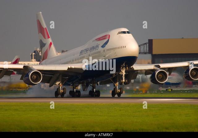 British Airways Boeing 747 touching down at London Heathrow Airport - Stock Image