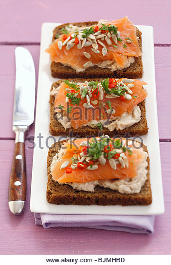 Smoked salmon open sandwiches - Stock Image