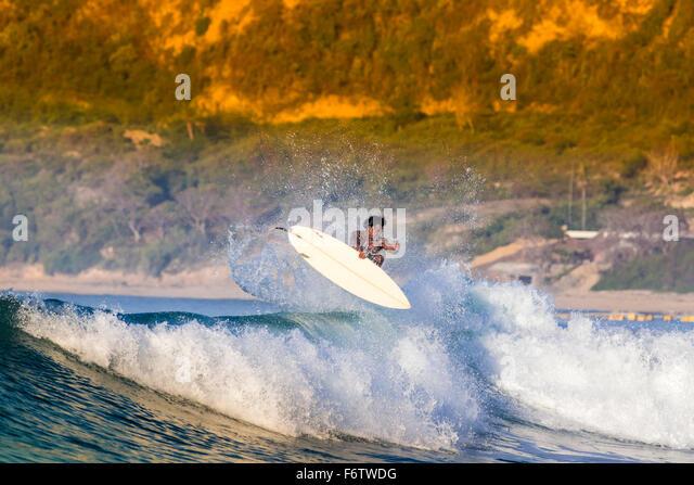 Indonesia, Lombok, surfing man - Stock Image