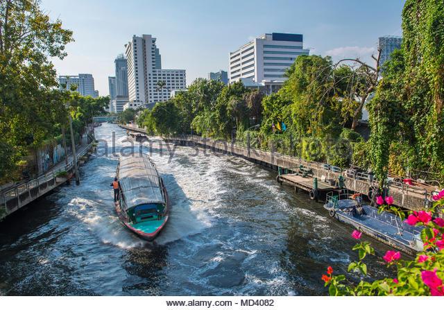 Passenger boat on canal, Bangkok, Thailand - Stock Image