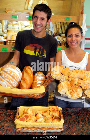 Buenos Aires Argentina Avenida Rivadavia bakery baked goods bread Hispanic man woman young adult attendant counter - Stock Image