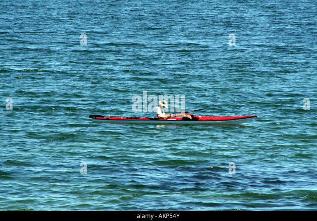 Canoeist on Yellowstone Lake - Stock Image