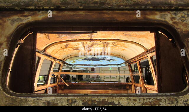 View Of Inside Of Rusted Body Of Minivan Through Rear Window - Stock Image