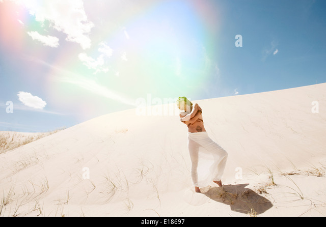 Beautiful woman in the dunes. - Stock Image