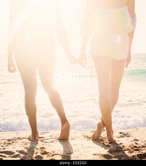 Female friends on beach - Stock Image