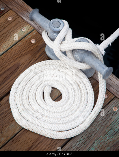 Rope used to tie up a boat to the dock in Roche Harbor, San Juan Island in Washington state, USA - Stock Image