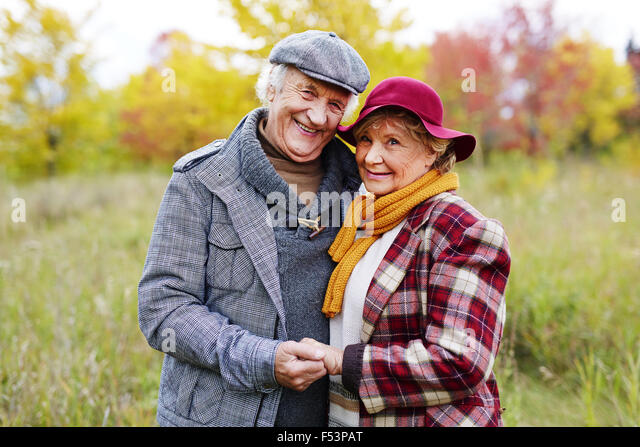 Positive loving senior couple posing for camera - Stock Image